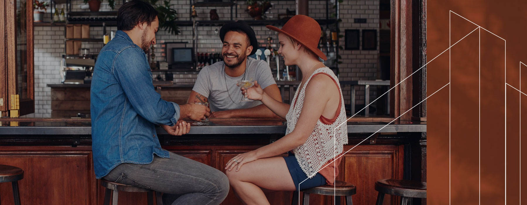 lifestyle image of a few people chatting in a bar